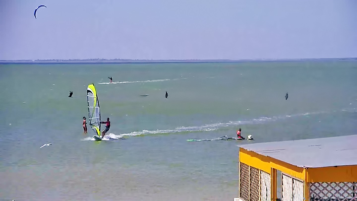 Kitesurfing and windsurfing on the firth of the Fedot Spit in Kirillovka